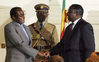 Mugabe+++Tsvangirai+Handshake+at+Signing+of+Agreement